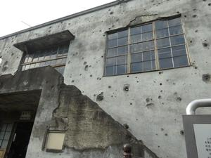 Outer wall which innumerable bullet holes can identify